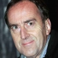 Colin Priestleyplayed by Angus Deayton