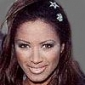 Traci Bingham - Feature Reporterplayed by Traci Bingham