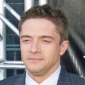 Topher Grace played by Topher Grace