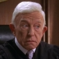 Judge Clark Brownplayed by Henry Gibson