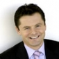 Sports Presenter played by Chris Hollins