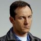 Michael Caffee played by Jason Isaacs