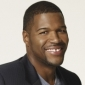 Mike Trainor played by Michael Strahan