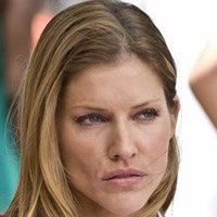 Carla played by Tricia Helfer