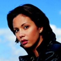 Tina Backus played by Lexa Doig