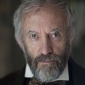 Mr Buxton played by Jonathan Pryce