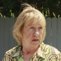 Karen McCluskey played by Kathryn Joosten