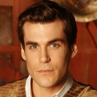 Dr. Simon Tam played by Sean Maher