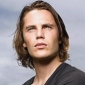 Tim Rigginsplayed by Taylor Kitsch