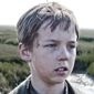 Young Pip played by Oscar Kennedy