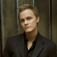 Adam Monroe played by David Anders