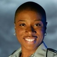 Mona Gomez played by Aisha Hinds