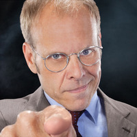 Commentator played by Alton Brown