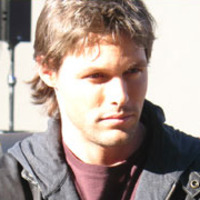 Mike Tracerplayed by Justin Bruening