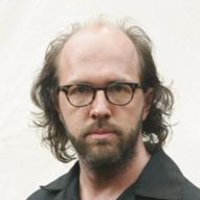 Stuart Radzinsky played by Eric Lange