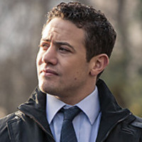 DS Justin Ripley played by Warren Brown