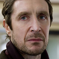 Mark North played by Paul McGann