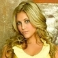 Lauren Tanner played by Cassie Scerbo