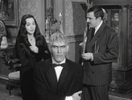 Lurch and his harpsichord morticia frump addams so you see lurch in as