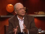 The Colbert Report Simon Johnson, Peter Singer