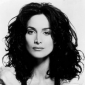 Carrie Spencer played by Carrie-Anne Moss