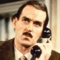 The Announcer played by John Cleese
