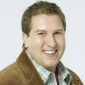 Roman Cohen played by Nate Torrence