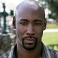 Aaron Mosely played by D.B. Woodside