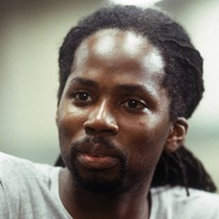 Augustus Hill played by Harold Perrineau