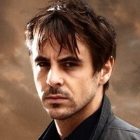 Dr Christian Kingplayed by Emun Elliott