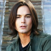 Caleb Rivers played by Tyler Blackburn