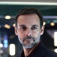 Philip Burton played by Alexander Siddig