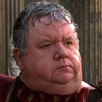 Newsreader played by Ian McNeice