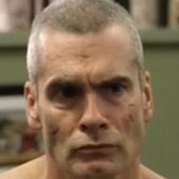 AJ Weston played by Henry Rollins