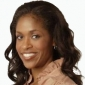 Kelly Palmer played by Merrin Dungey