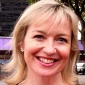 Herself - Reporter played by Carol Kirkwood