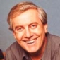 Himself - Reporter played by Gyles Brandreth