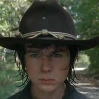 Carl Grimes played by Chandler Riggs