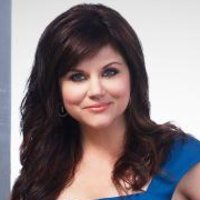 Elizabeth Burke played by Tiffani Thiessen