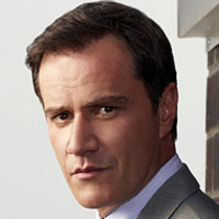 Peter Burke played by Tim DeKay