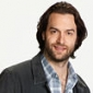 Alexplayed by Chris D'Elia